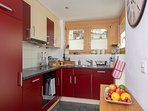 Well equipped kitchen with access to the balcony