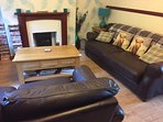 The lounge has an electric log burner and is comfortably furnished