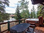 Private hot tub and outdoor dining area with mountain views
