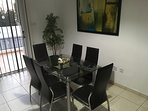 Modern dining area with plenty space for 6 guests.