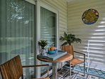 Relax with a cool beverage on the private screened-in porch.