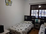 Twin bedroom with large double wardrobe and air conditioning