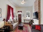 Living room - front door, queen sleeper sofa, 55' cable HDTV.