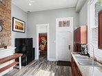Full kitchen - doors to backyard and full bathroom; original 100+ year old brickwork.