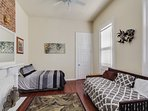Bedroom 1. 1 full bed, 2 twin beds (trundle), dedicated AC unit + central HVAC.