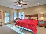 The master bedroom also features a king bed and patio access.