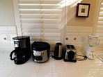Appliances include, coffee maker, rice cooker, toaster, blender and hot water pot.