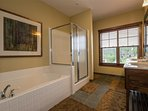 Enjoy your private en-suite Master Bathroom with soaking tub and separate shower.