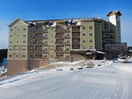 Groomed ski trails come up to Soaring Eagle Lodge, and the ski storage room inside the door.