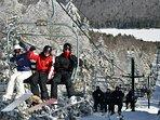 Riding Powderidge Lift as it approaches the summit.