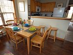 'Eat In-Save Money' fully stocked kitchens and dining tables.
