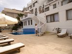 Large Terrace with pppool and spiral staircase leading up to Manzarali Private,Gated Balcony