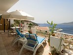 Large balcony, overlooking the sea, for dining and sunbathing