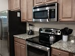 This granite and steel kitchen has more appliances, cooking, and serving tools than other rentals.