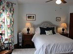 Queen upholstered bed with three light - filled windows