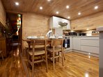 The Kitchen - shows the Walnut flooring of to a trerat.