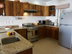 Open design kitchen is equipped with all the essential appliances.