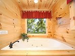 Jacuzzi Tub in King Bedroom at Moonbeams & Cabin Dreams