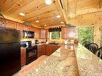 Kitchen and Breakfast Bar at Moonbeams & Cabin Dreams