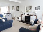 The comfy sitting room with views across the estuary and Galloway hills beyond.