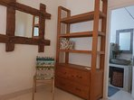Bedroom equipped with large teak wood cabinet with drawers, mirror, chair and its attached bathroom