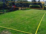 The volleyball net on the lawn covered area will offer you many hours of fun!