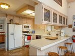 Gourmet kitchen with gas stove and a convection/microwave.