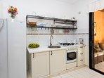 Kitchen has full stove / oven.