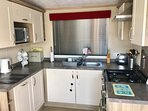 Modern kitchen with washer/dryer,diswasher gas cooker ,microwave and inbuilt fridge/freezer