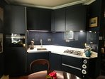 Kitchen with gas hob, dishwasher and Siemens combi oven and fridge freezer