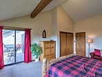 The expansive master suite reveals stunning mountain and lake views!