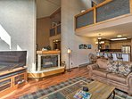 Cozy up by the fire and enjoy family favorites on the flat-screen TV.