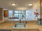 Step inside the fully equipped kitchen which has stainless steel appliances.
