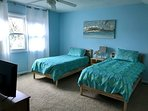 The third floor loft bedroom has two twin beds and a private bathroom.