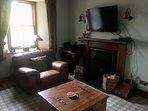 Open fireplace and satellite television with DVD player