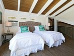 Makai loft bedroom with ocean view balcony, outdoor shower and choice of King bed or two Twin beds.