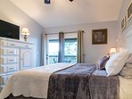 The master bedroom grants easy access to the spacious patio.