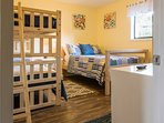 This bedroom offers a full bed and a twin-over-twin bunk bed.