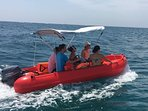 8-seat motor boat (for hire at £65/half day).  Great fun and easy to use – no experience required