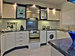 Main Kitchen with AEG washing and drier machine and dishwasher machine