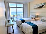 Second Bedroom with Sea view two single beds.(Can be converted to King)
