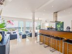 Open floor plan faces you when you enter Villa Ginborn, living room, kitchen, pool terrace and view