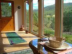 Front, lower sun room off living area, looks into Taos Canyon and the mts over Angel Fire! Sweet!