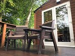 The deck is ideal for a peaceful morning coffee or an evening toast.