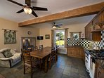 Farmhouse kitchen with multi-fuel log burner and range cooker.