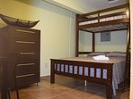 Studio (room 4) has 1 full bed, 1 twin day bed, 1 comfortable folding cot a full bath & a kitchenett