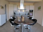 Kitchen with island unit and breakfast bar