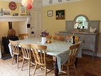 Kitchen with large table  great for cosy gatherings