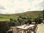 Eat and drink on the patio at Lane Farm Holiday Cottages, and enjoy the fabulous view...