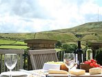 Eat and drink on the patio at Lane Farm Holiday Cottages, and enjoy the fabulous view....